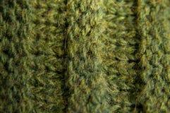 Μάλλινο υπόβαθρο σύστασης, πλεκτό ύφασμα μαλλιού, πράσινο τριχωτό fluf Στοκ Εικόνες