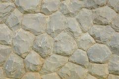 Μέρος ενός γκρίζου τοίχου πετρών, για το υπόβαθρο Στοκ εικόνα με δικαίωμα ελεύθερης χρήσης