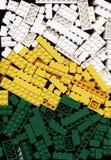 Μέρος του άσπρου, κίτρινου και πράσινου υποβάθρου παιχνιδιών τούβλων Lego Στοκ εικόνα με δικαίωμα ελεύθερης χρήσης