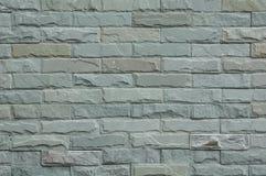 Μέρος του γκρίζου τετραγωνικού τοίχου πετρών για το υπόβαθρο Στοκ Φωτογραφία