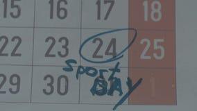 Μέρος του ημερολογιακού φύλλου με τη χαρακτηρισμένη ημερομηνία ως αθλητική ημέρα με την μπλε μάνδρα δεικτών φιλμ μικρού μήκους