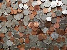 μέρος των νομισμάτων πενών δολαρίων στις διαφορετικές μετονομασίες, το υπόβαθρο και τη σύσταση στοκ φωτογραφία με δικαίωμα ελεύθερης χρήσης