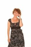Μέση ηλικίας γυναίκα στο τηλέφωνο Στοκ φωτογραφία με δικαίωμα ελεύθερης χρήσης