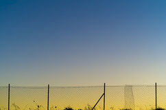 Μέταλλο καθαρό στο ηλιοβασίλεμα Στοκ φωτογραφία με δικαίωμα ελεύθερης χρήσης