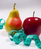 Μέτρο της Apple, αχλαδιών και ταινιών, έννοια διατροφής Στοκ Εικόνες