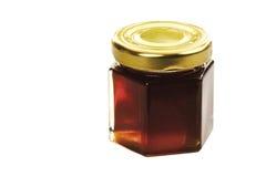 Μέλι ανθών δέντρων ασβέστη στο βάζο γυαλιού που απομονώνεται στο λευκό Στοκ Φωτογραφίες