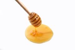 Μέλι κουταλιών σούπας στο λευκό Στοκ Φωτογραφίες