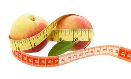 Μήλο έννοιας ικανότητας Μήλο με τη μέτρηση Στοκ Εικόνα