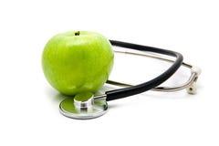 Μήλο και stetoskop Στοκ εικόνα με δικαίωμα ελεύθερης χρήσης
