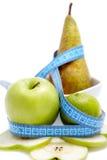 μήλο που μετρά το αχλάδι Στοκ Εικόνες