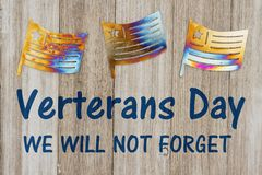 Μήνυμα ημέρας παλαιμάχων με τις σημαίες μετάλλων ελεύθερη απεικόνιση δικαιώματος