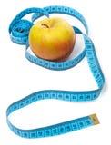Μήλο και ταινία μέτρου Στοκ Εικόνες