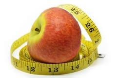 μήλο που μετρά την ταινία Στοκ Φωτογραφίες