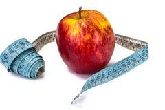 μήλο που μετρά το λευκό ταινιών Στοκ Εικόνα