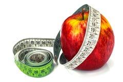μήλο που μετρά το λευκό ταινιών Στοκ φωτογραφία με δικαίωμα ελεύθερης χρήσης