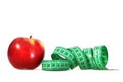 μήλο που μετρά το λευκό ταινιών Στοκ Εικόνες