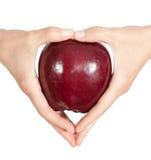 Μήλο σε ένα χέρι Στοκ Φωτογραφίες