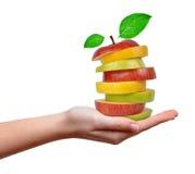 Μίγμα της Apple στα χέρια Στοκ Εικόνες