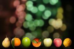 Μίγμα των juicy τροφίμων μαξιλαριών φρούτων ζωηρόχρωμων στο μαύρο υπόβαθρο Στοκ Εικόνα