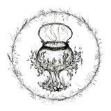 Μαγεία του λέβητα σε ένα πλαίσιο του στεφανιού Στοκ Εικόνα