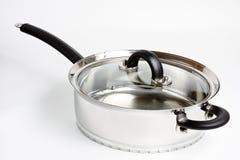 μαγείρεμα σε κατσαρόλα &alp Στοκ Εικόνα