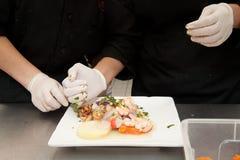 Μαγείρεμα χεριών Στοκ Φωτογραφία