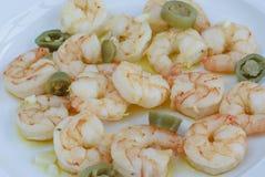 Μαγειρευμένες γεύμα γαρίδες με το πιπέρι στο πιάτο στο softfocus Στοκ εικόνα με δικαίωμα ελεύθερης χρήσης
