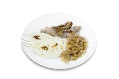 Χοιρινό κρέας, μπουλέττες και sauerkraut Στοκ Εικόνες
