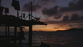 Μαγική άποψη ηλιοβασιλέματος στο χωριό Moresby, Παπούα απόθεμα βίντεο