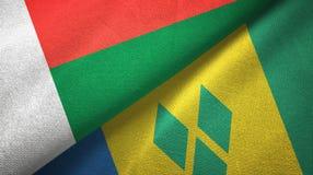 Μαδαγασκάρη και Άγιος Βικέντιος και Γρεναδίνες δύο υφαντικό ύφασμα σημαιών απεικόνιση αποθεμάτων