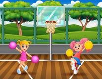 Μαζορέτες που χορεύουν στο γήπεδο μπάσκετ απεικόνιση αποθεμάτων
