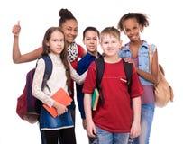 Μαθητές με τη διαφορετικά χροιά και τα ενδύματα στοκ φωτογραφία με δικαίωμα ελεύθερης χρήσης