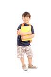 Μαθητής με το σακίδιο πλάτης που κρατά ένα σημειωματάριο Στοκ Φωτογραφίες