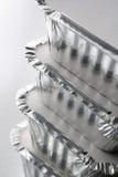 μακριά η στοίβα φύλλων αλουμινίου εμπορευματοκιβωτίων παίρνει Στοκ Εικόνες