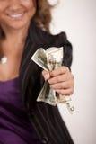 μακριά δίνοντας τα χρήματα Στοκ Φωτογραφίες