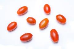 Μακροεντολή μιας συλλογής πέντε κόκκινων ντοματών δαμάσκηνων Datterino Στοκ φωτογραφία με δικαίωμα ελεύθερης χρήσης