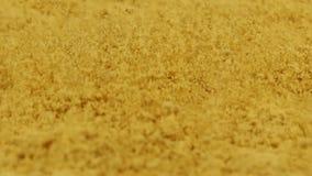 ΜΑΚΡΟΕΝΤΟΛΗ: Παφλασμός turmeric της σκόνης - σε αργή κίνηση απόθεμα βίντεο