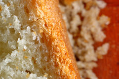 Μακροεντολή κινηματογραφήσεων σε πρώτο πλάνο του ψωμιού και crumbs ψωμιού Στοκ Εικόνες
