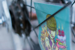 Μακρο λεπτομέρεια μιας κάρτας κινούμενων σχεδίων σε μια ρόδα ποδηλάτων Στοκ Εικόνες