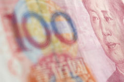 Μακρο-πυροβοληθείς για Renminbi (RMB), 100 εκατό δολάρια. Στοκ Φωτογραφίες