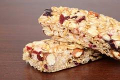 Μακρο φραγμός ρηχό DOF granola καρυδιών φρούτων Στοκ Εικόνα