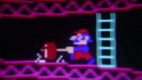 Μακρο $cu «Mario» ο πρωταγωνιστής από «το γάιδαρο Kong» κλασικό αναδρομικό Arcade Vide απόθεμα βίντεο