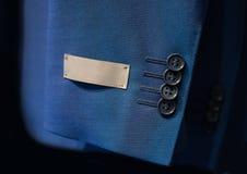 Μανίκι σακακιών με μια ετικέτα Στοκ φωτογραφία με δικαίωμα ελεύθερης χρήσης