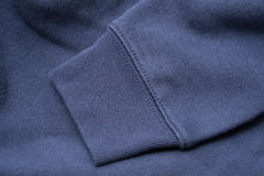 Μανίκι της μπλε μπλούζας Στοκ εικόνα με δικαίωμα ελεύθερης χρήσης