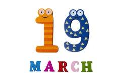 19 Μαρτίου στο άσπρους υπόβαθρο, τους αριθμούς και τις επιστολές Στοκ Εικόνες