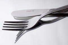 Μαχαίρι και δίκρανο στο λευκό στοκ φωτογραφία με δικαίωμα ελεύθερης χρήσης