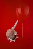 μαχαίρι χεριών μπαλονιών πλ&et Στοκ εικόνα με δικαίωμα ελεύθερης χρήσης