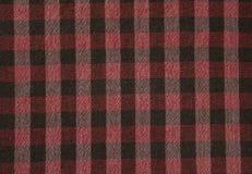 Μαύρα άσπρα κόκκινα τετράγωνα στο ύφασμα στοκ εικόνες με δικαίωμα ελεύθερης χρήσης