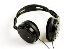 μαύρα ακουστικά Στοκ εικόνα με δικαίωμα ελεύθερης χρήσης