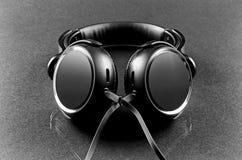 Μαύρα ακουστικά Στοκ Εικόνες